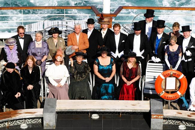 People in period costume aboard MS Balmoral Titanic