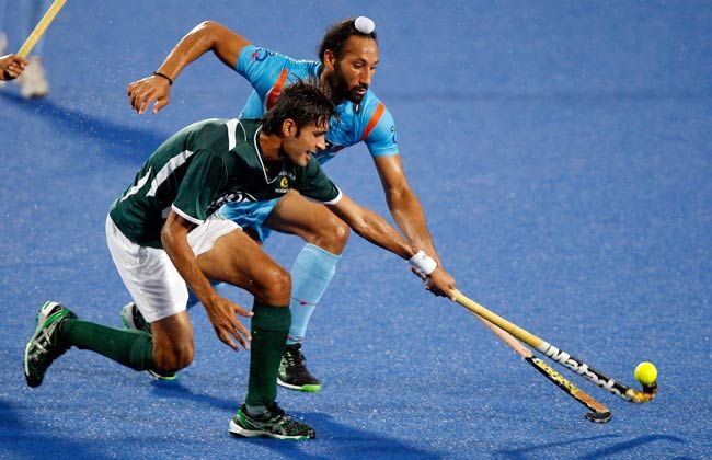 Shafqat Rasool battles for the ball with Dharamvir Singh