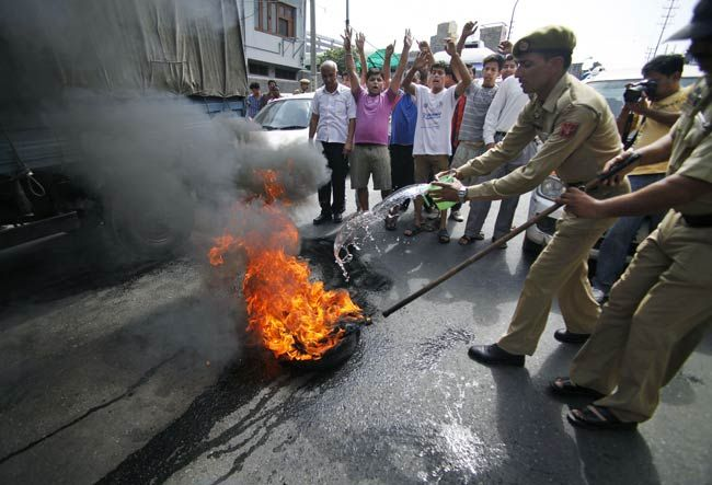 Cops douse fire during the all India strike in Jammu