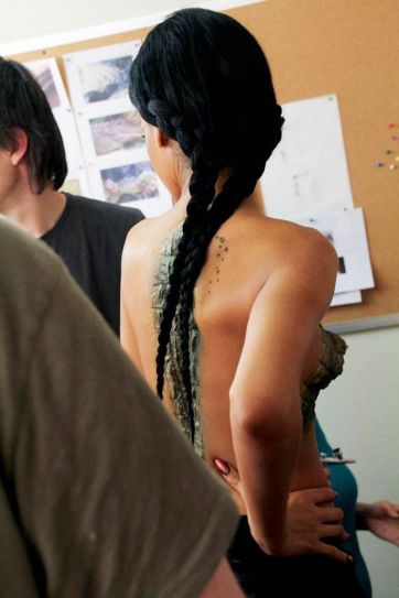Rihanna strips for a new video