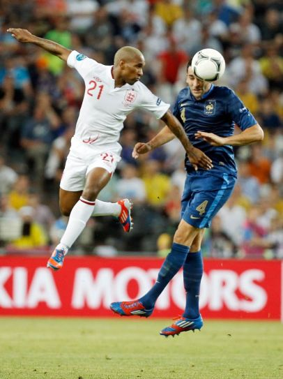Jermain Defoe (left) and France's Adil Rami