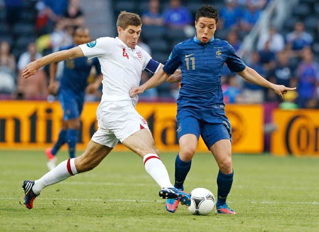 Samir Nasri (right) and England's Steven Gerrard