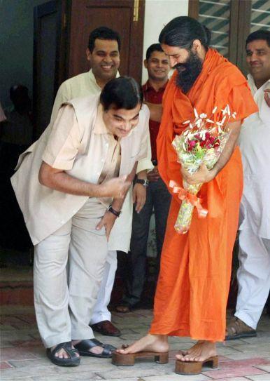 Nitin Gadkari touches Ramdev's feet