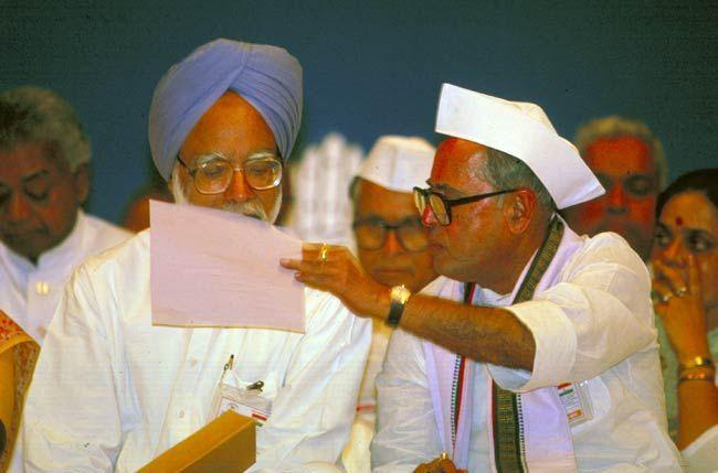 Pranab Mukherjee (right) and Manmohan Singh