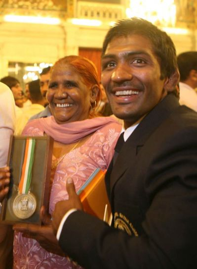 Olympic hero wrestler Yogeshwar Dutt with his mother