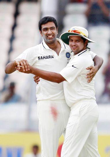 Ravichandran Ashwin (left) and Suresh Raina