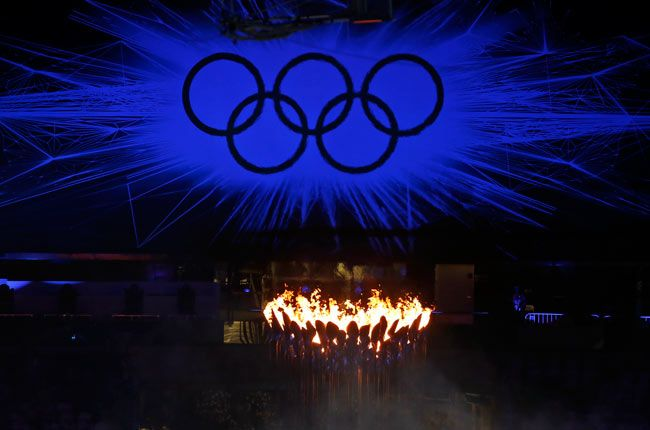 The Olympic Flame burns as the Olympic Rings stand illuminated