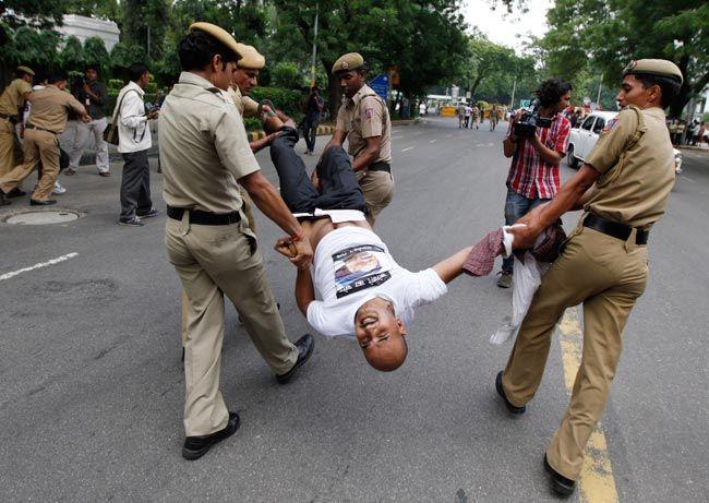 Police remove a protester
