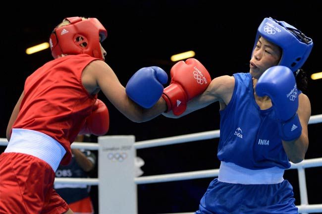 Mary Kom Hmangte (right) fights Maroua Rahali of Tunisia