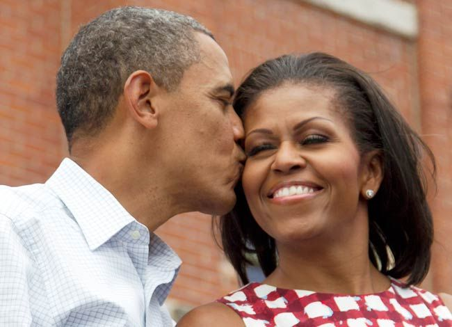 Obamas' kiss has a marker