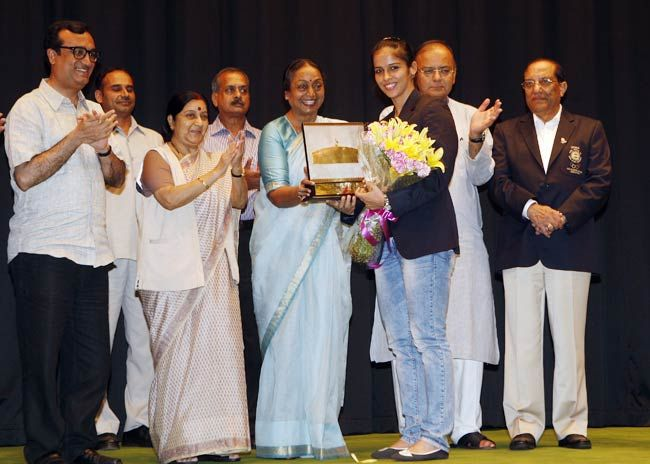 Olympic medal winners during a function.