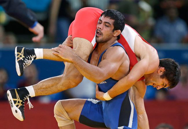 Ikhtiyor Navruzov of Uzbekistan (left) and Sushil Kumar.