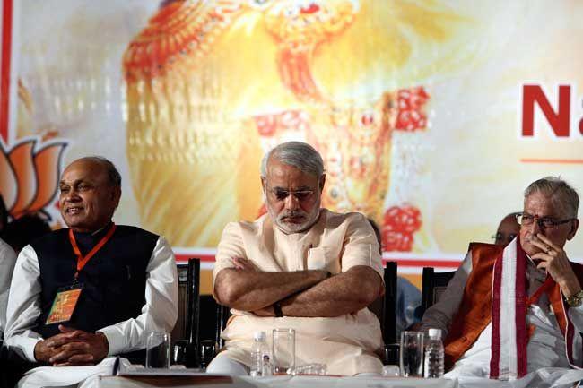(From left) Himachal Pradesh CM Prem Kumar Dhumal, Gujarat CM Narendra Modi and Murli Manohar Joshi
