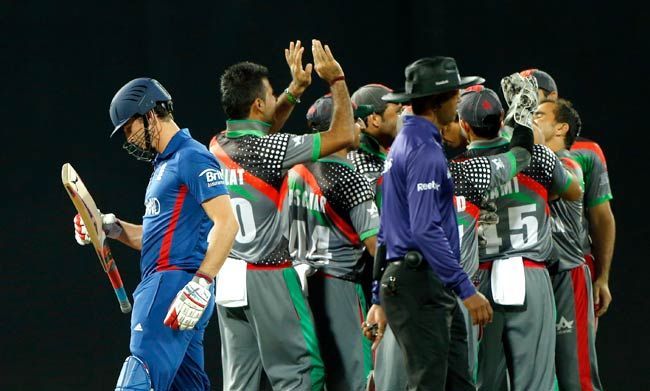 Afghanistan players celebreate wicket of Craig Kieswetter (left)