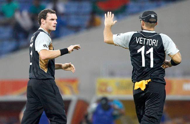 Kyle Mills, left, with teammate Daniel Vettori