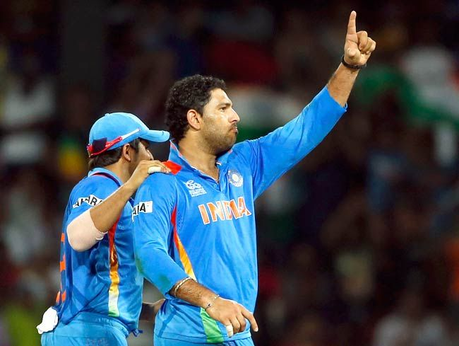 Yuvraj Singh celebrates the dismissal of Pakistan's batsman Kamran Akmal