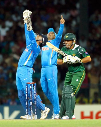 Dhoni, left, and Sehwag celebrate the dismissal of Pakistan's batsman Kamran Akmal