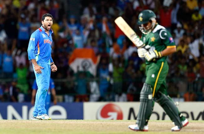 Yuvraj Singh celebrates the dismissal of Pakistan's batsman Kamran Akmal (right)