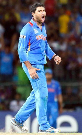 Yuvraj Singh celebrates the dismissal of Pakistan's batsman Kamran Akmal