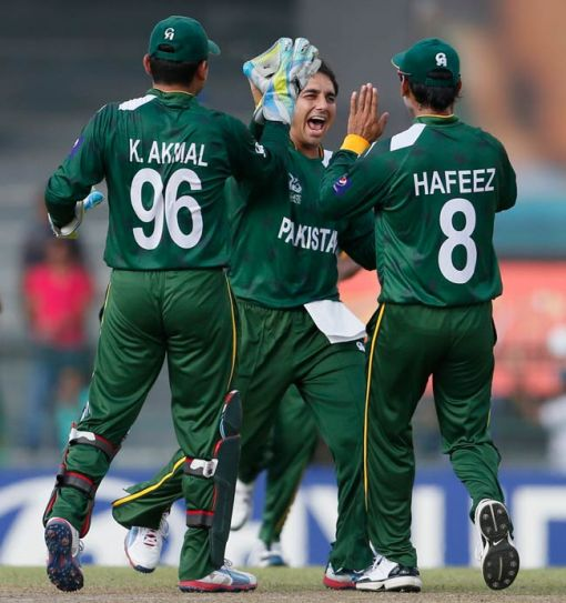 Saeed Ajmal (center) with teammates