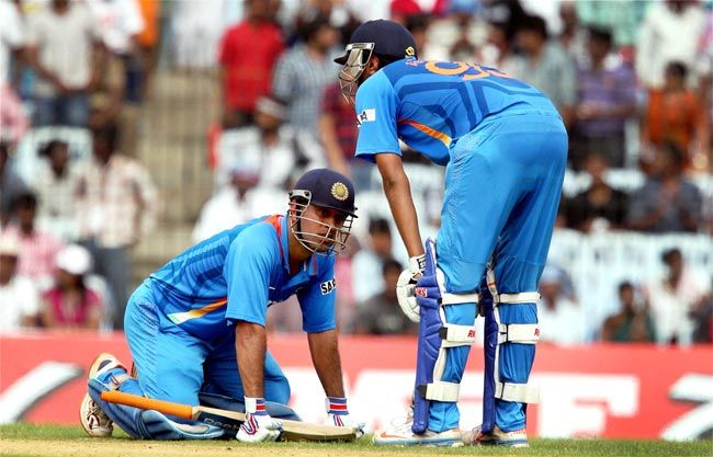 MS Dhoni and R Ashwin take rest during their innings in Chennai.