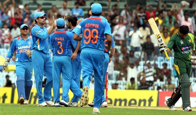 Indians celebrate the wicket of Younis Khan.
