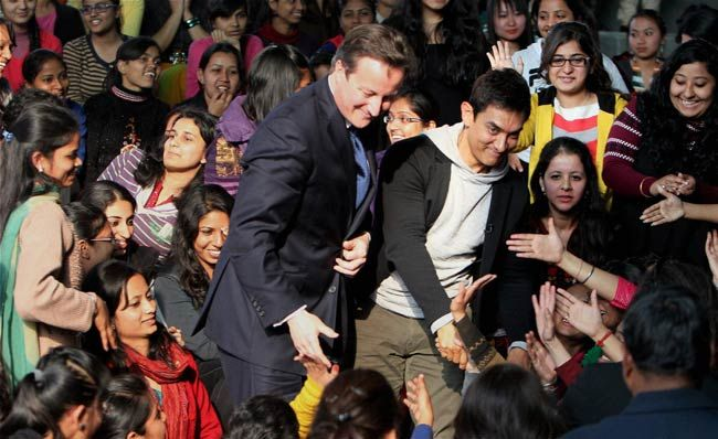 British PM David Cameron with actor Aamir Khan with students