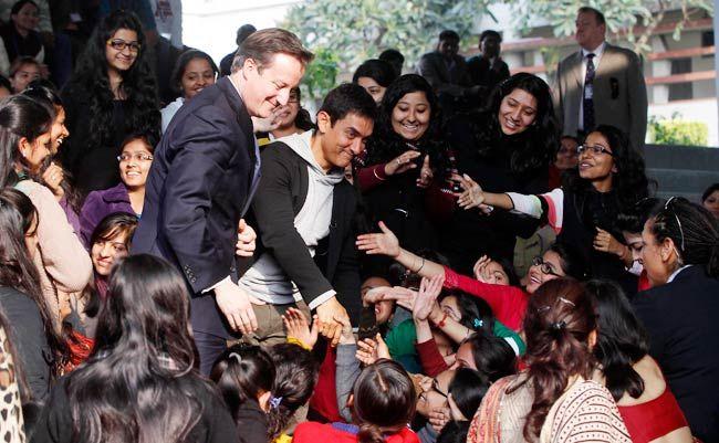 British PM David Cameron with actor Aamir Khan among students