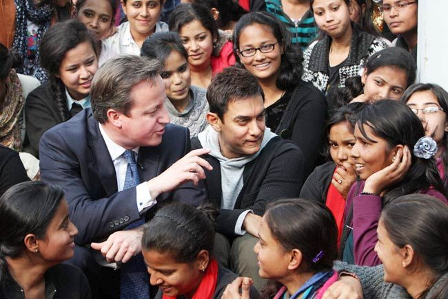 British PM David Cameron with actor Aamir Khan sitting with students