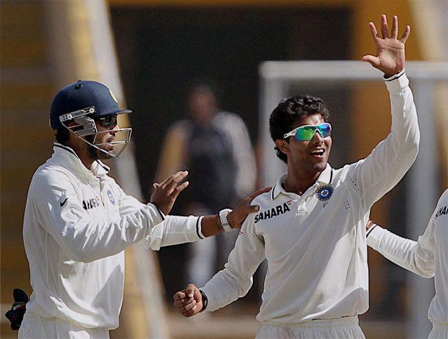 R Jadeja with M Vijay celebrates the wicket of Australian player Michael Clarke