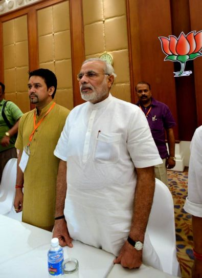 Anurag Thakur (left) and Narendra Modi