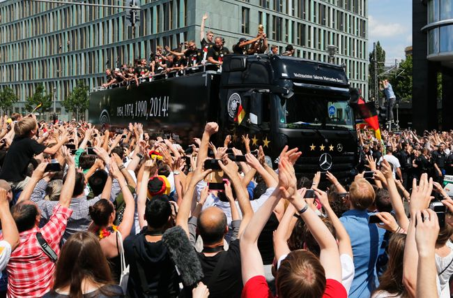 German players get a rousing welcome after World Cup victory
