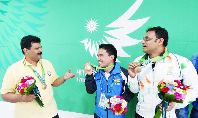 India's Bronze medalists, Jitu Rai, Samaresh Jung and Prakash Papanna Nanjappa