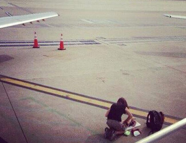 lady with her baby in the tarmac