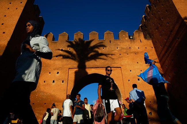 People walk through Bab el Had gates of Rabat's Medina