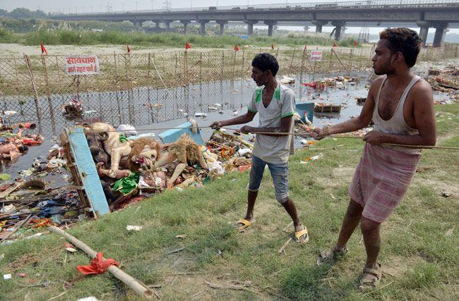 Durga Puja idols immersed in Yamuna river