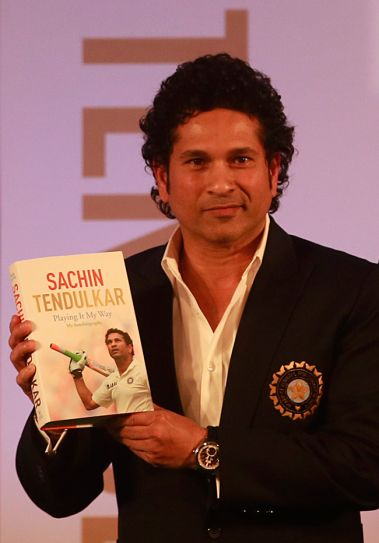 Sachin poses with his autobiography 'Playing It My Way'