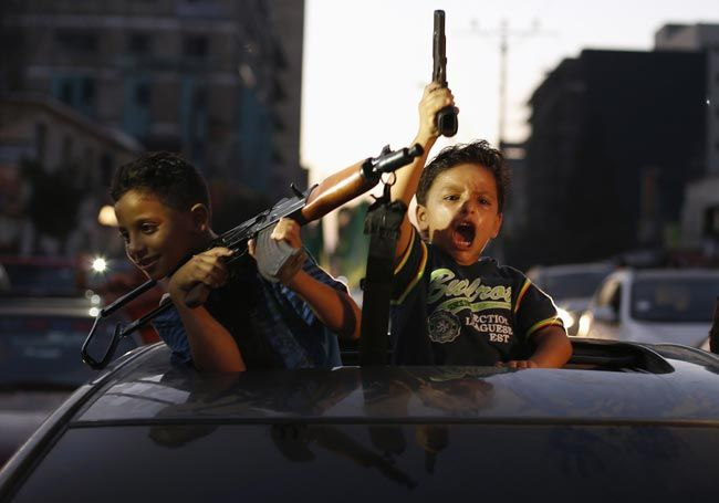 Palestinian children hold guns
