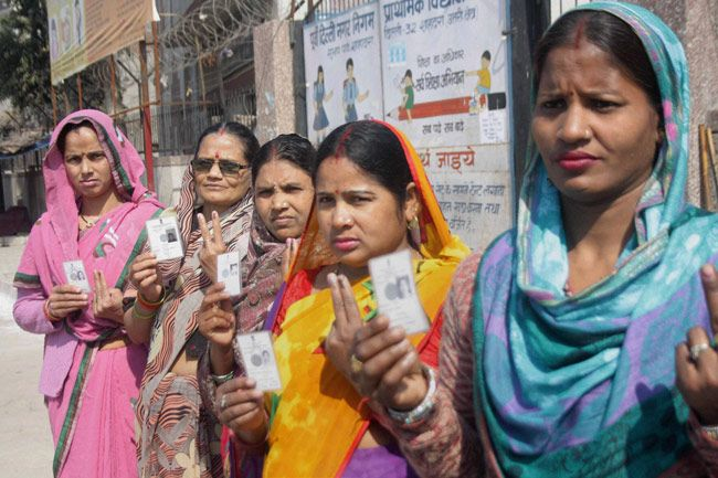 Female voters displaying their inked fingers.