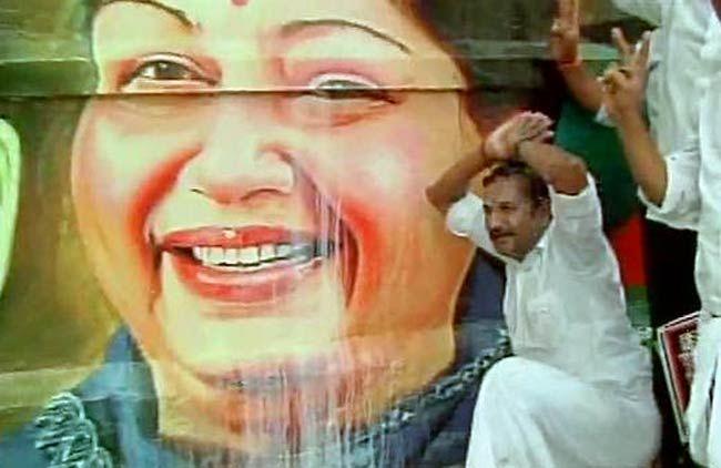 Supporters celebrate Jayalalithaa's acquittal