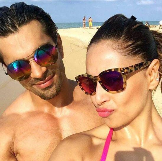 Bipasha Basu and Karan Singh Grover at a beach