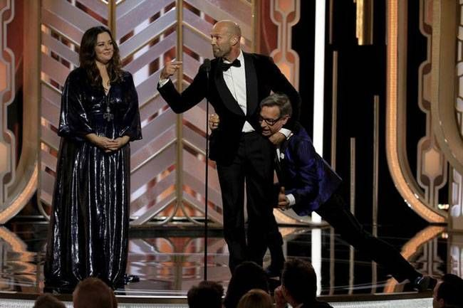 Melissa McCarthy (L) Jason Statham (C) and Paul Feig