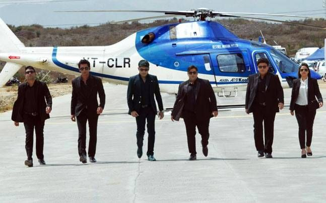 Kapil Sharma and his team members, all dressed in black, walk together in the first look of the promo shoot for their new show.