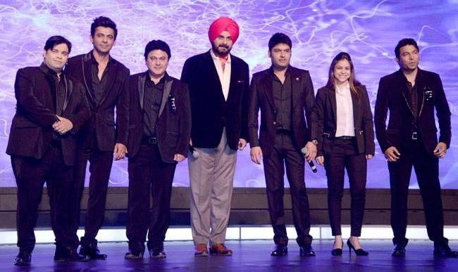 Men (and woman) in Black: Kiku Sharda, Sunil Grover, Ali Asgar, Navjot Singh Sidhu, Kapil Sharma, Sumona Chakravarty and Chandan Prabhakar were super-excited at the trailer launch of The Kapil Sharma Show.