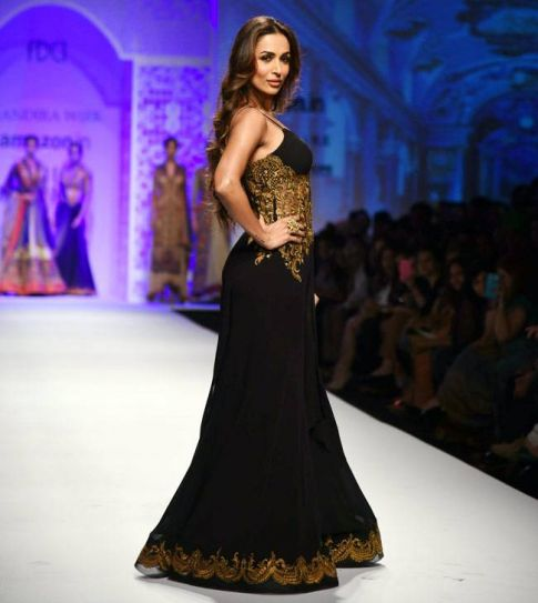 The goegeous Malaika Arora Khan set the ramp on fire with her pretty black and beige gown as she walked the ramp for designer Mandira Wirk on the fourth day of the ongoing Amazon India Fashion Week (AIFW) winter-festive 2016.