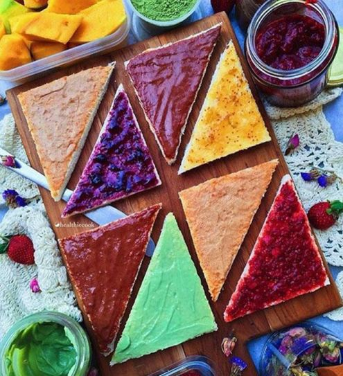 Creative but natural jam toppings (blueberry, raspberry, mint, honey, chocolate, peanut butter) make these toasts naturally rainbow coloured.