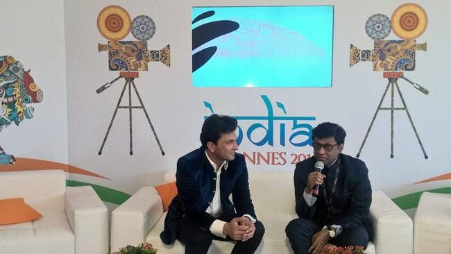 Chef Vikas Khanna with Dr. Mohan Kumar, the Indian Ambassador to France, at the unveiling of Kitchens of Gratitude at the India Pavilion, Cannes.