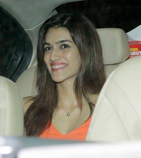 Kriti Sanon chose to wear an orange attire to the party.