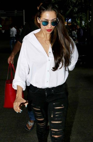 The ever-stylish Malaika Arora looked smouldering hot in black ripped jeans and white top.