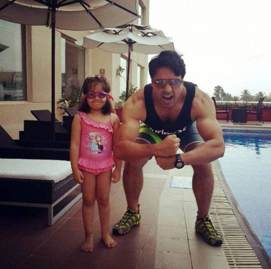 Iqbal Khan gives a hulk pose for his daughter Ammaara. But the little one looks amused.